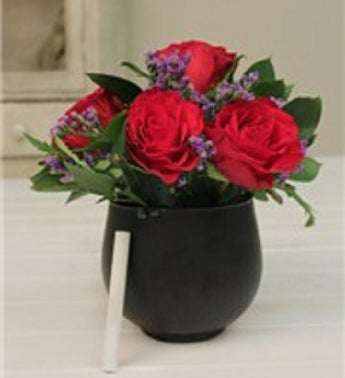 Red Roses in a Chalkboard Vase