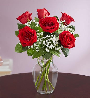 three or six roses in a vase