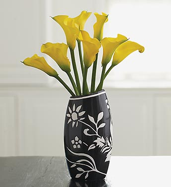 yellow mini calla lilies in ceramic vase