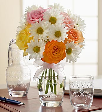 roses, daisy poms in etched glass carafe
