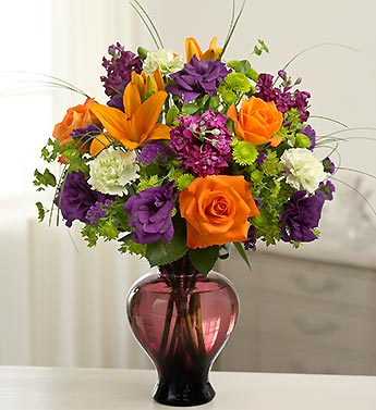 mixed fall arrangement in lavender glass vase