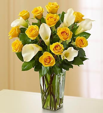 white and yellow rose bouquets. yellow rose and white calla