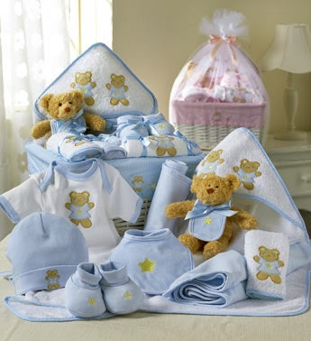 pink or blue baby gift set in white basket